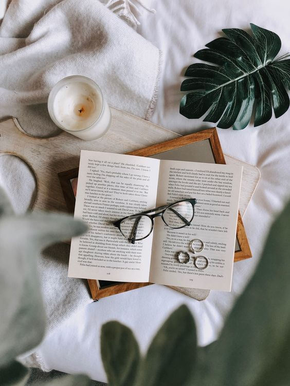 The glasses are centered in this flat lay photo. Notice how it also brings in some lifestyle elements